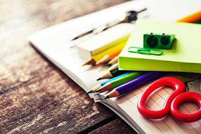 school supplies wooden background