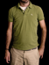 man wearing green polo