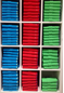 folded stacks of colorful polos