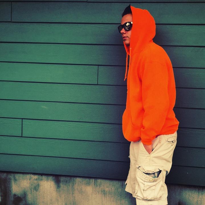 Young man wearing orange hoodie