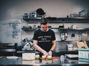 Man working in kitchen uniform t shirt