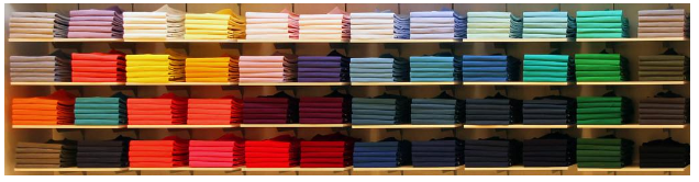 Stacks of t-shirts on shelves