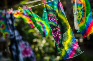 tie dye apparel hanging on clothesline