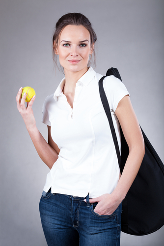 Female tennis player wearing polo shirt