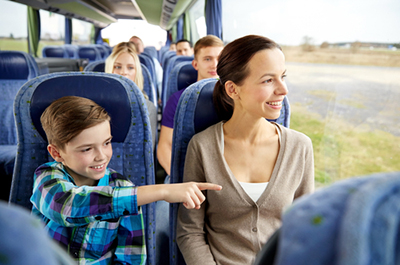 mother and son riding in bus
