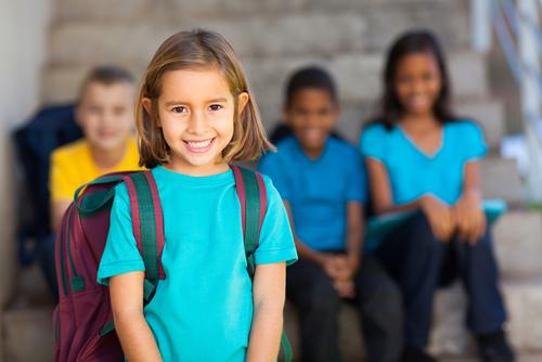 preschool girl with schoolmates in background