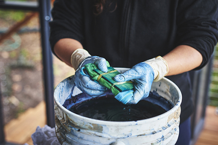 woman tie dyeing clothes