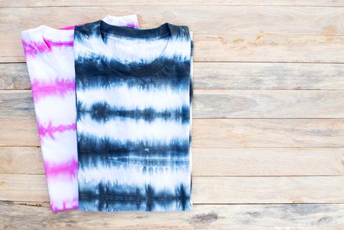 tie dye lightweight cotton shirts wooden background