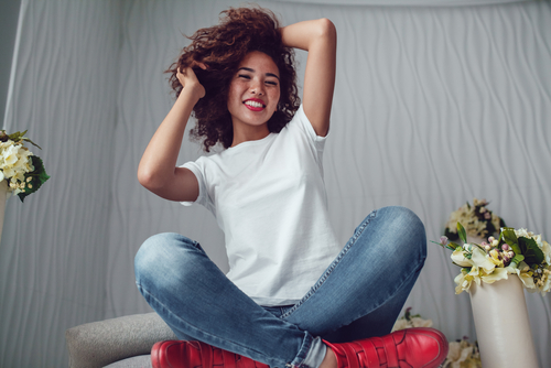 Curly haired girl with freckles in blank white t-shirt