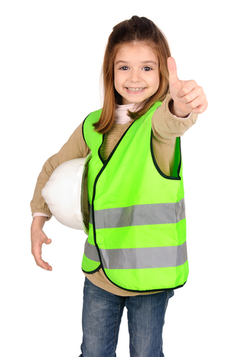 little girl with reflective vest