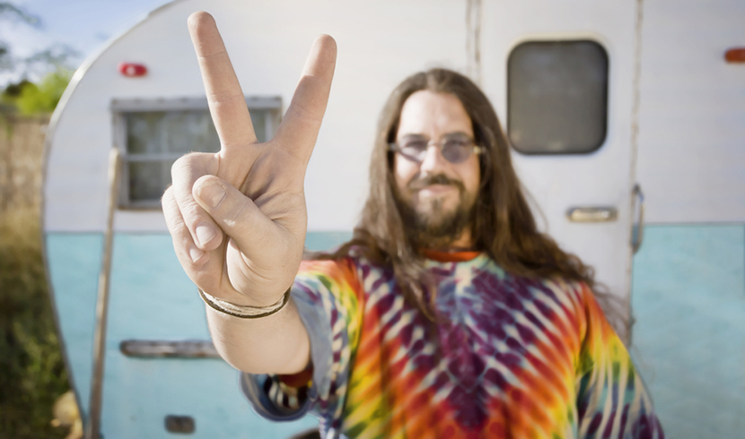man in tie dye shirt peace sign