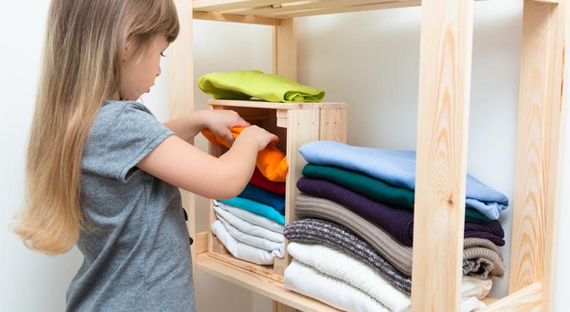 girl sorting laundry in room