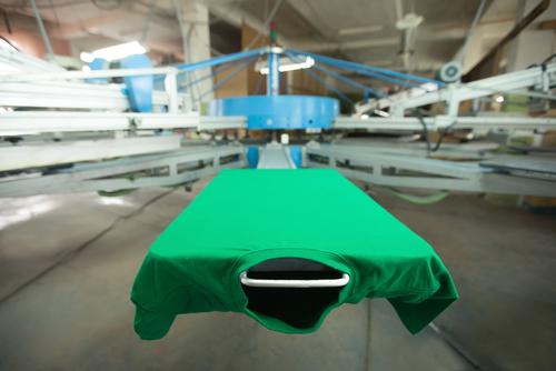green t shirt on silk screen printing machine