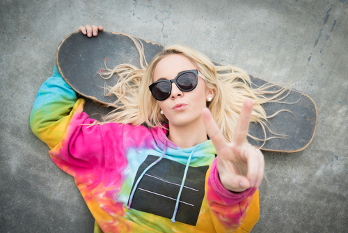 blonde skater giving peace sign