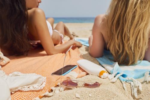 friends tanning at beach