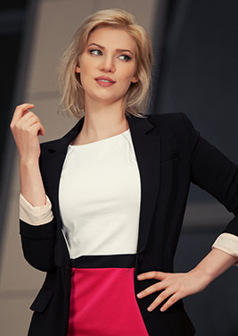 stylishly dressed woman wearing white shirt and blazer