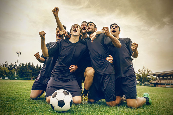 soccer team cheering together
