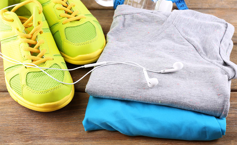 sports clothing on wooden surface