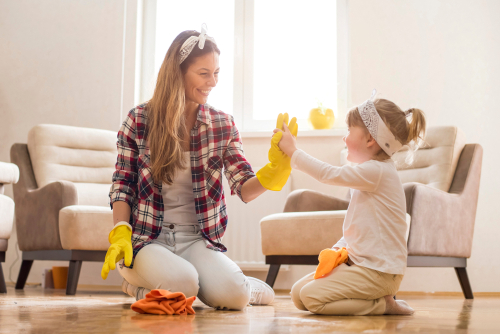Mother and daughter cleaning