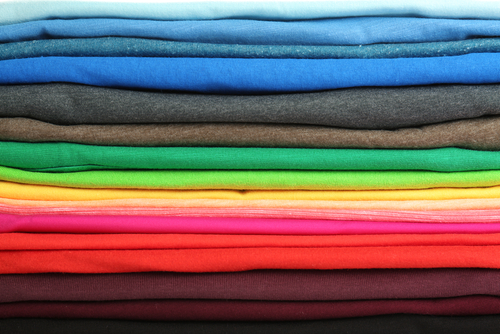 closeup stack of folded t shirts