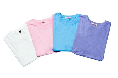 colorful arrangement of folded t shirts