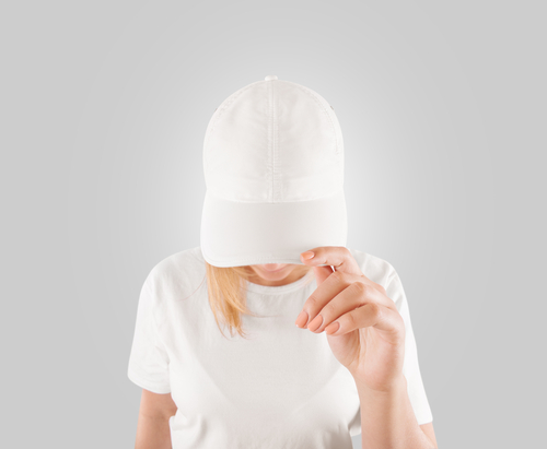 woman wearing plain baseball cap