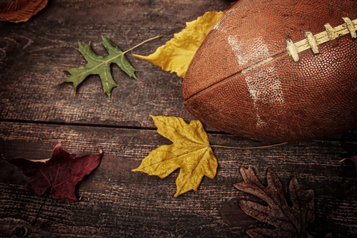 football on table with autumn leaves