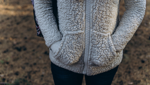 womans hands in fluffy hoodie