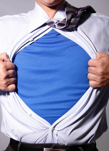 man pulling t shirt open