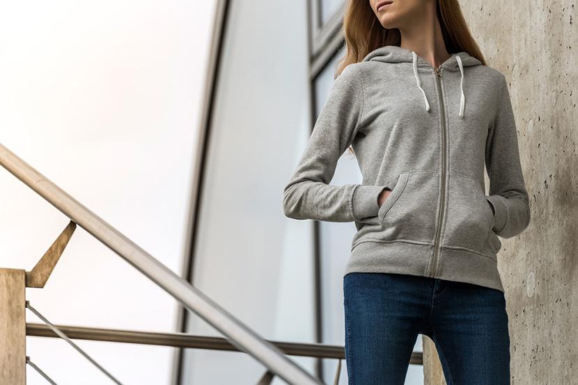 Woman wearing blank grey hoodie