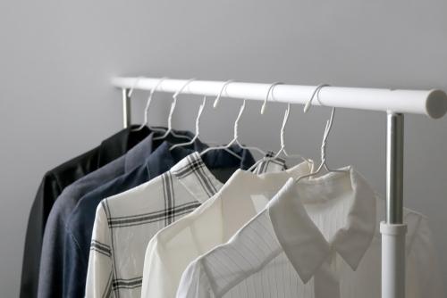 capsule wardrobe clothes on rack