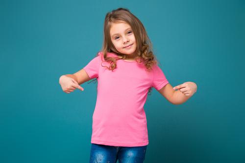 girl pointing at pink t shirt