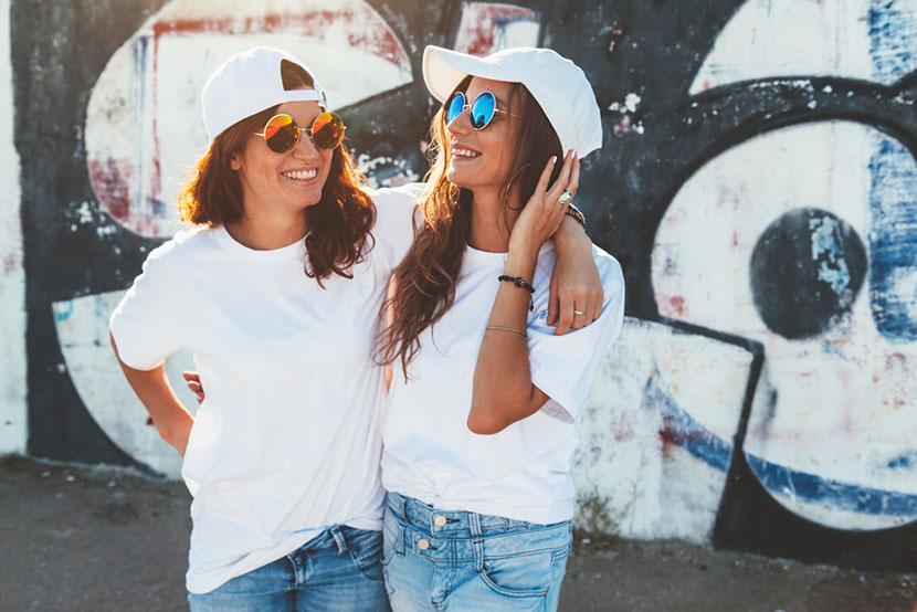 happy women in short sleeve shirts