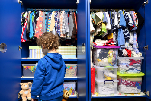 kids closet with clothes and toys