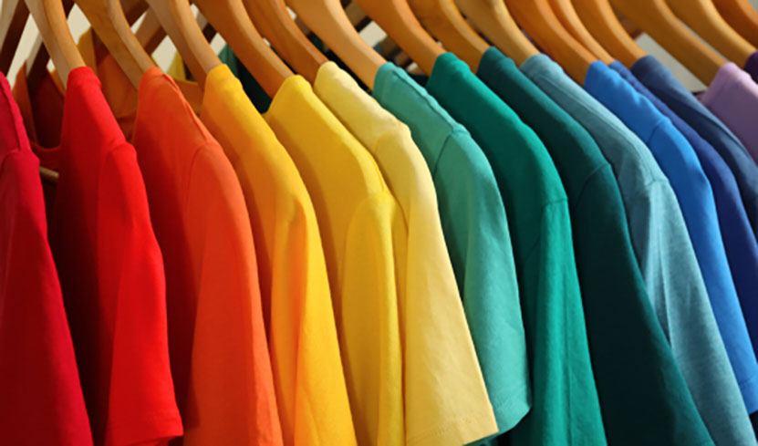 colorful t shirts on clothing rack