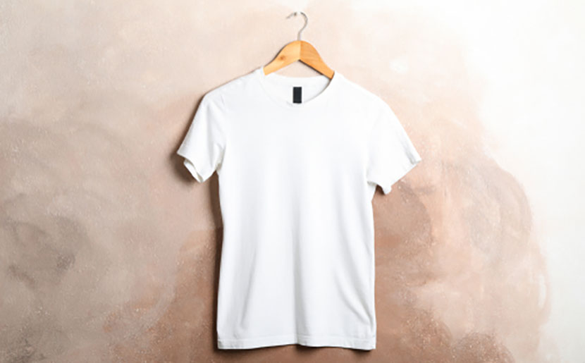 white shirt hanging on wall