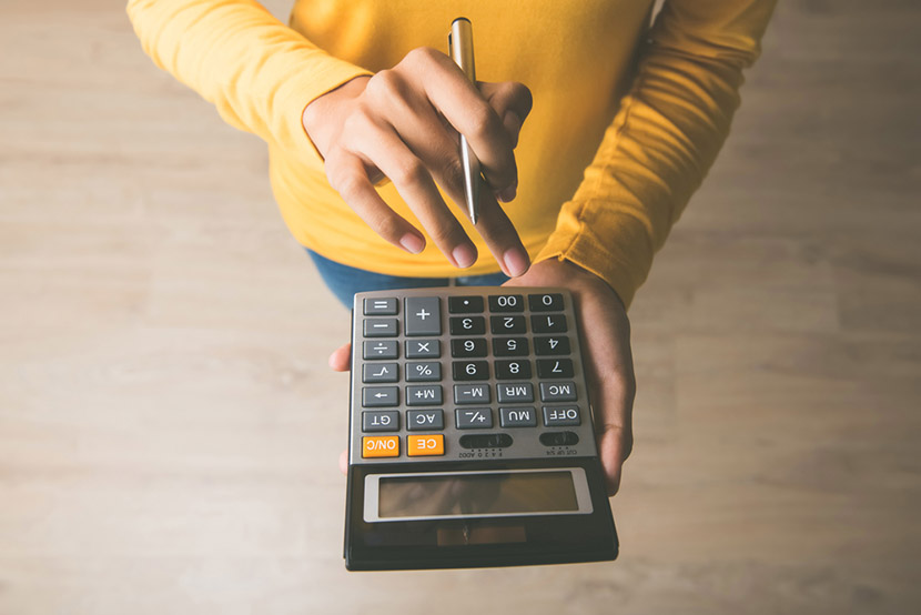 Woman entrepreneur using a calculator