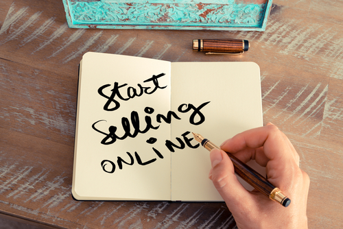 writing start selling online in notebook